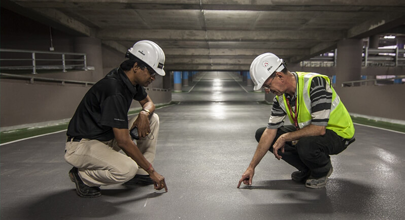Client, Patient and Broker Testimonials: Two Industrial Employees Examine Floor of Mill